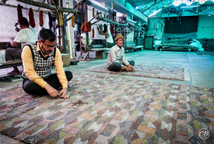 Trimming, combing, and preparing of the rugs